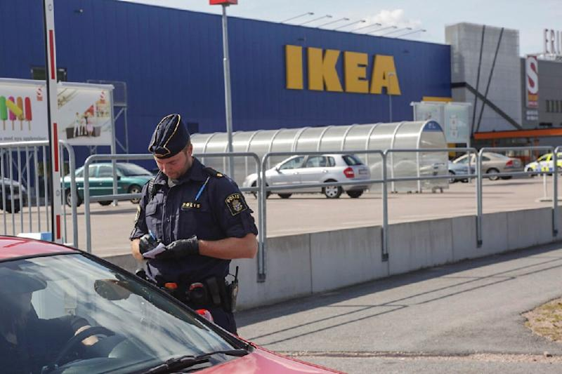 A policeman gathers evidence outside the Ikea story in Vasteras, Sweden (AFP Photo/Peter Kruger)