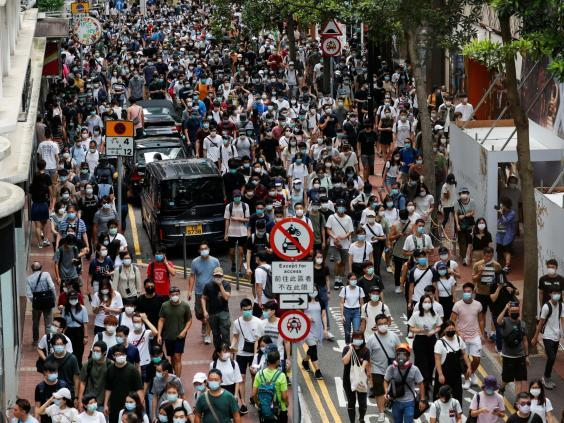 Anti-national security law protesters march at the anniversary of Hong Kong's handover to China from Britain, in Hong Kong, China July 1, 2020. (Tyrone Siu/Reuters)