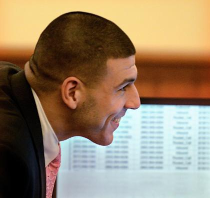 Aaron Hernandez smiles during a light moment of the murder trial of Odin Lloyd. (AP)