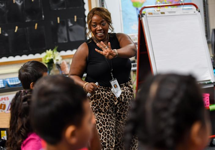 Naomi Blank teaches her English-learner students on the first day of the school year at Jane Addams Elementary School in Sioux Falls, S.D.