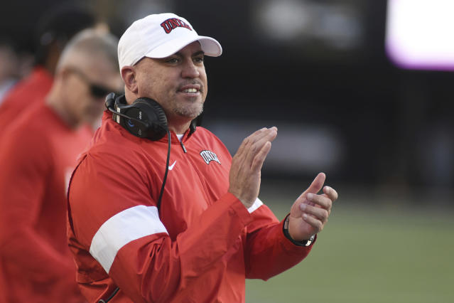 UNLV Head Coach Tony Sanchez encourages his team against Vanderbilt in the second half of an NCAA college football game Saturday, Oct. 12, 2019, in Nashville, Tenn. (AP Photo/Mike Strasinger)
