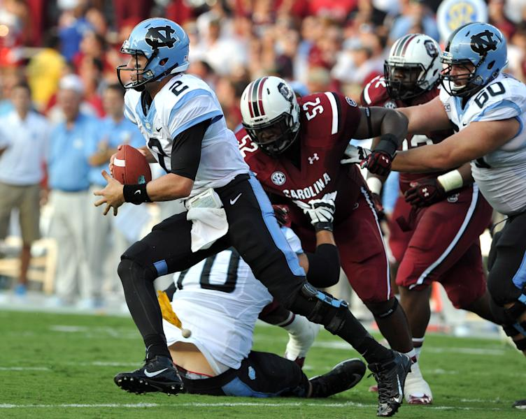 North Carolina quarterback Bryn Renner (2) scrambles out of the pocket during the first half of an NCAA college football game against South Carolina, Thursday, Aug. 29, 2013, in Columbia, S.C. (AP Photo/Stephen Morton)