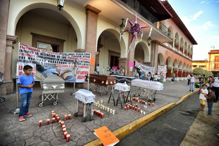 Residents posed with symbolic coffins to protest against violence and organized crime after the January 2015 killings in Apatzingan