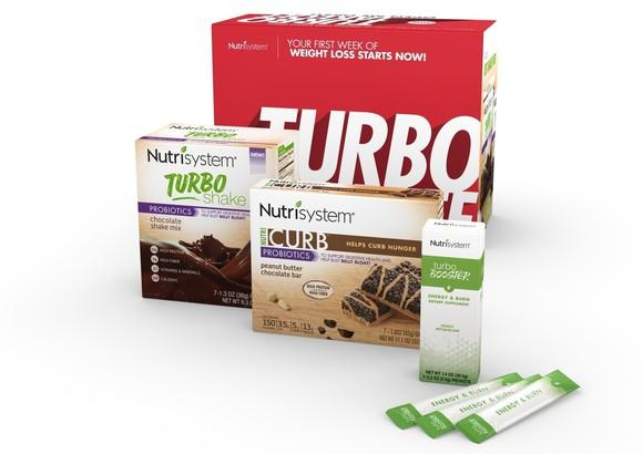 Several boxes of Nutrisystem Turbo and Curb brand products.