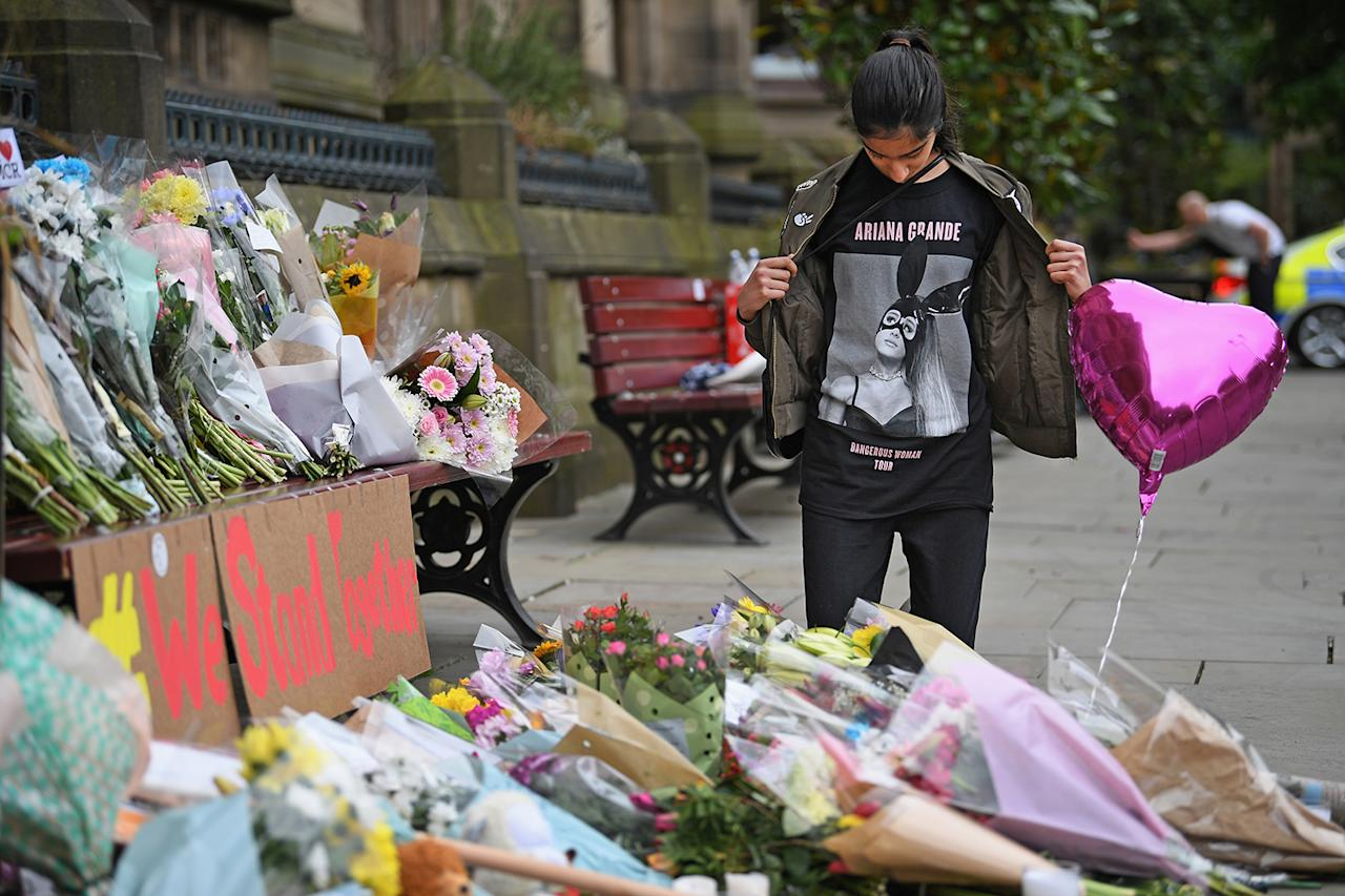 "<p>Tragedy struck an Ariana Grande concert in May, when a <a rel=""nofollow"" href=""https://www.yahoo.com/news/live-updates-multiple-fatalities-blast-ariana-grande-concert-manchester-arena-000236450.html"">terrorist bombing</a> killed 22 and injured more than 500 as she wrapped up the Manchester leg of her ""Dangerous Woman"" world tour. Grande subsequently suspended her tour to deal with the tragedy, sharing how she felt ""<a rel=""nofollow"" href=""https://www.yahoo.com/entertainment/ariana-grande-breaks-silence-suspends-tour-suspected-terrorist-attack-concert-034534666.html"">broken</a>"" on Twitter. She then organized the ""One Love Manchester"" concert, with proceeds benefiting the families of the <a rel=""nofollow"" href=""https://www.yahoo.com/entertainment/ariana-grande-arrives-u-k-ahead-one-love-manchester-benefit-concert-142250146.html"">victims of the attack</a>. Katy Perry, Miley Cyrus, Pharrell Williams, Coldplay, Justin Bieber, Usher, and Niall Horan joined the event, causing tickets to sell out in six minutes. Before the concert, Grande <a rel=""nofollow"" href=""https://www.yahoo.com/entertainment/ariana-grandes-one-love-manchester-benefit-concert-full-emotional-moments-103146214.html"">visited</a> those who were injured <a rel=""nofollow"" href=""https://www.yahoo.com/entertainment/ariana-grande-visits-fans-injured-manchester-attack-000103238.html"">in the hospital</a>. (Photo: Getty Images) </p>"