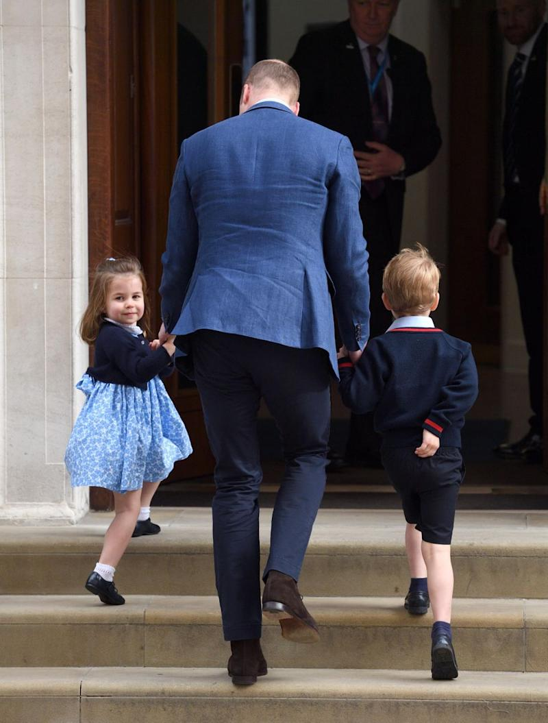Unlike her camera-shy brother, Charlotte happily waved to crowds. Photo: Getty