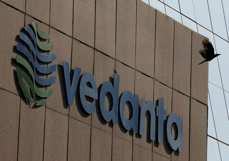 FILE PHOTO: A bird flies past the logo of Vedanta installed on the facade of its headquarters in Mumbai