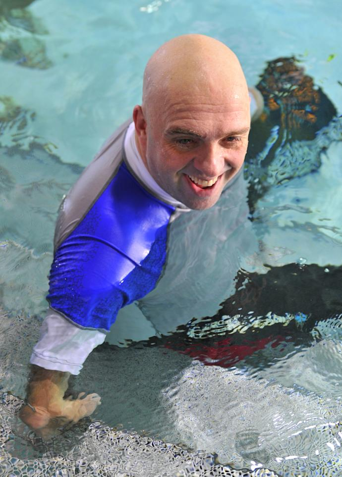 French Philippe Croizon, 44, celebrates on January 10, 2013 after becoming the first quadruple amputee to dive at a depth of 33 meters in the deepest swiming pool in the world in Brussels. He used flippers attached to prosthetic limbs to dive to the bottom of the pool with a group of 15 Belgian divers to set a new world record for an amputee.   Croizon had all four limbs amputated in 1994 after being struck by an electric shock of more than 20,000 volts as he tried to remove a TV antenna from a roof. He has swum across the English Channel and all five intercontinental channels.  AFP PHOTO  GEORGES GOBETGEORGES GOBET/AFP/Getty Images