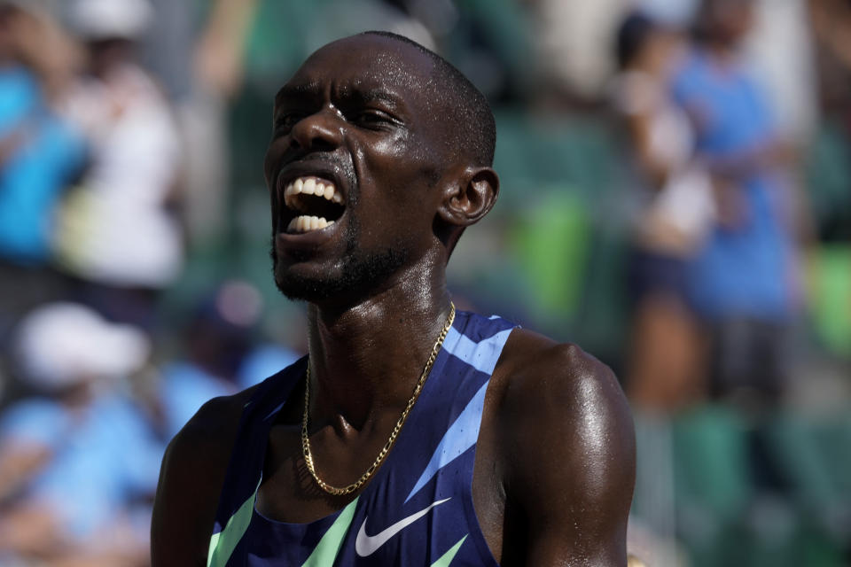 Paul Chelimo celebrates after his win in the finals of men's 5000-meter run at the U.S. Olympic Track and Field Trials Sunday, June 27, 2021, in Eugene, Ore. (AP Photo/Ashley Landis)