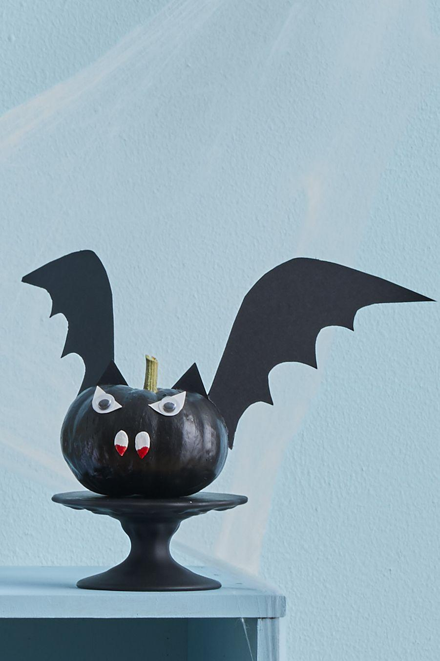 """<p>Paint any mini pumpkin all black, use pumpkin seeds for teeth with a hint of blood, of course, cut his ears and wings our of card stock and glue googly eyes on top of eye-shaped paper cutouts. <strong><br></strong></p><p><a class=""""link rapid-noclick-resp"""" href=""""https://www.amazon.com/TOAOB-Assorted-Adhesive-Scrapbooking-Accessories/dp/B01HEDV9SC/?tag=syn-yahoo-20&ascsubtag=%5Bartid%7C10070.g.331%5Bsrc%7Cyahoo-us"""" rel=""""nofollow noopener"""" target=""""_blank"""" data-ylk=""""slk:SHOP GOOGLY EYES"""">SHOP GOOGLY EYES</a> </p>"""