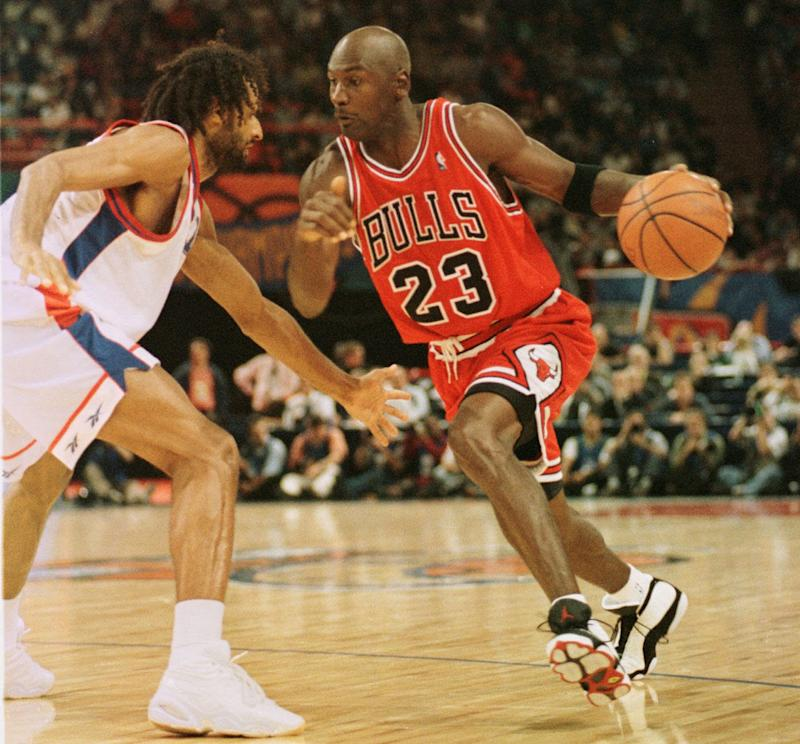 Chicago Bulls star Michael Jordan, right, dribbles PSG Racing Stephane Risacher, during the McDonald's championship semi final match between PSG Racing of France and US Chicago Bulls at the Paris Bercy stadium on Friday Oct. 17, 1997. The Chicago Bulls won 89/82.(AP PHOTO/Michel Lipchitz)