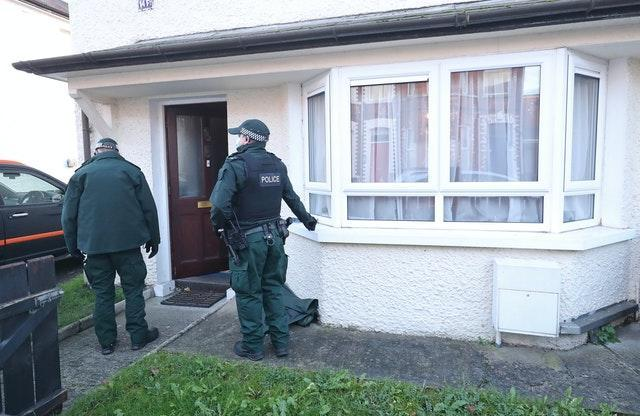 Police search a property in south Belfast in connection with the bombings