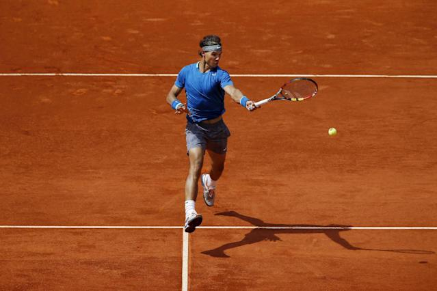 Rafael Nadal from Spain returns the ball during a Madrid Open tennis tournament match against Jarkko Nieminen, from Finland, in Madrid, Spain, Thursday, May 8, 2014 . (AP Photo/Daniel Ochoa de Olza)