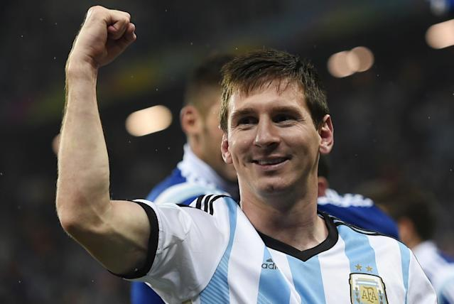 Argentina's forward and captain Lionel Messi celebrates after winning their FIFA World Cup semi-final match against the Netherlands in a penalty shoot-out following extra time at The Corinthians Arena in Sao Paulo on July 9, 2014 (AFP Photo/Fabrice Coffrini)