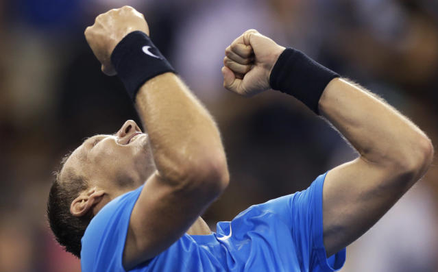 Tomas Berdych, of the Czech Republic, raises his arms after beating Roger Federer, of Switzerland, 7-6 (1), 6-4, 3-6, 6-3 in a quarterfinal of the U.S. Open tennis tournament, Wednesday, Sept. 5, 2012, in New York. (AP Photo/Charles Krupa)
