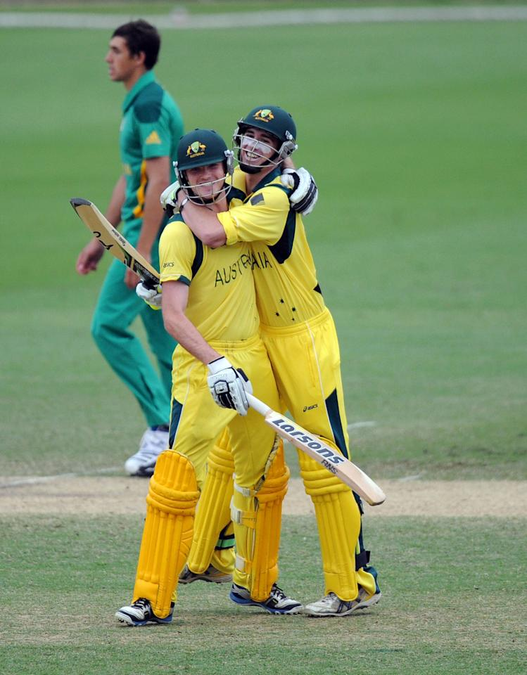 TOWNSVILLE, AUSTRALIA - AUGUST 21:  Ashton Turner (L) and Alex Gregory of Australia embrace after defeating South Africa during the ICC U19 Cricket World Cup 2012 Semi Final match between Australia and South Africa at Tony Ireland Stadium on August 21, 2012 in Townsville, Australia.  (Photo by Malcolm Fairclough-ICC/Getty Images)