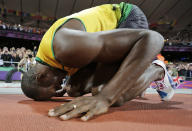 Jamaica's Usain Bolt celebrates winning gold in the men's 100-meter final during the athletics in the Olympic Stadium at the 2012 Summer Olympics, London, Sunday, Aug. 5, 2012. (AP Photo/David J. Phillip)