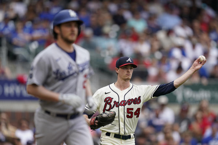 Atlanta Braves starting pitcher Max Fried (54) throws Los Angeles Dodgers starting pitcher Trevor Bauer (27) out at first base after a ground ball in the third inning of a baseball game Sunday, June 6, 2021, in Atlanta. (AP Photo/Brynn Anderson)