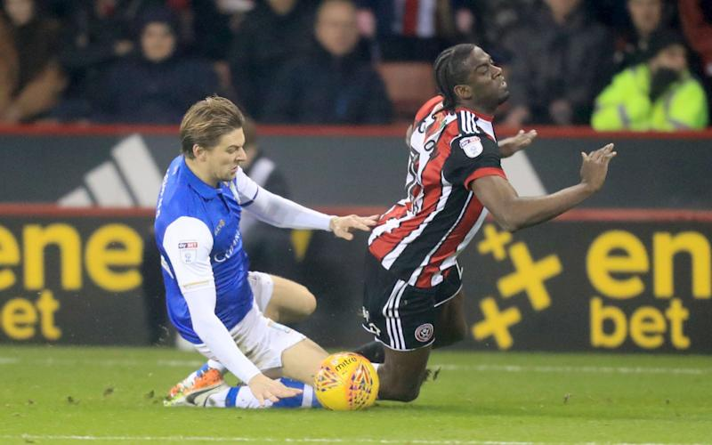 Wednesday's Glenn Loovens hacks down United's Clayton Donaldson and is sent off in the Sheffield derby - PA