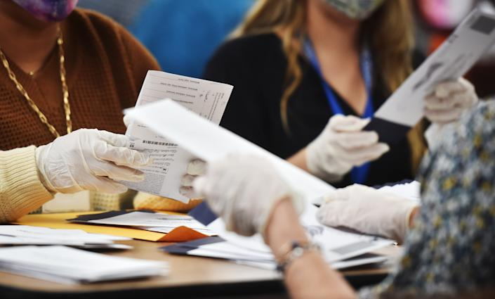 Luzerne County employees open mail-in ballots to be counted at the elections board in Wilkes-Barre. Pennsylvania on Nov. 4, 2020. (Aimee Dilger/SOPA Images/LightRocket via Getty Images)