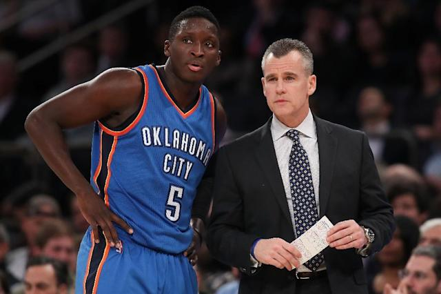 The Oklahoma City Thunder point guard Victor Oladipo and head coach Billy Donovan watch a NBA game at Madison Square Garden in New York (AFP Photo/Michael Reaves)