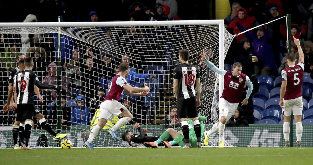 Burnley's Chris Wood, 2nd right, celebrates scoring his side's first goal of the game against Newcastle United during their English Premier League soccer match at Turf Moor in Burnley, England, Saturday Dec. 14, 2019. (Martin Rickett/PA via AP)