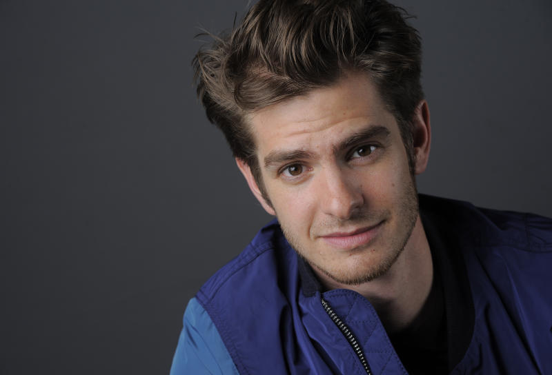 """In this Friday, July 19, 2013 photo, actor Andrew Garfield poses for a portrait on Day 3 of Comic-Con International in San Diego. Garfield stars in """"The Amazing Spider-Man 2,"""" set for release next year. (Photo by Chris Pizzello/Invision/AP)"""
