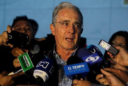 FILE PHOTO: Colombian former president and Senator Alvaro Uribe talks to the media after a meeting with Colombia's President Juan Manuel Santos over a new peace deal with Revolutionary Armed Forces of Colombia (FARC), at military air base in Rionegro, Colombia November 12, 2016. REUTERS/Fredy Builes/File Photo
