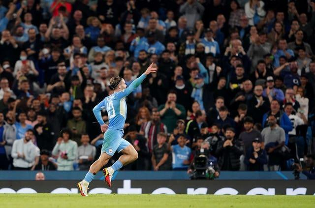 Jack Grealish celebrates scoring in the Champions League for Manchester City