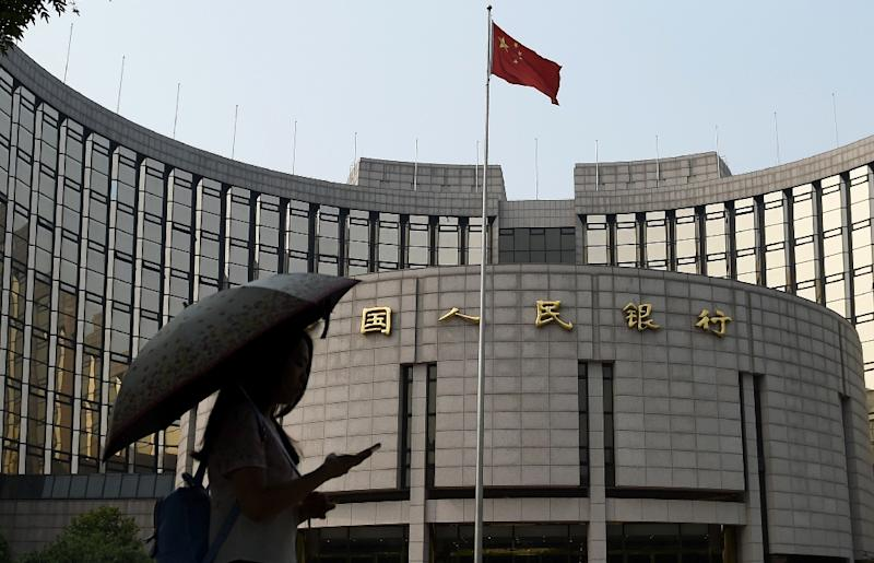 The central People's Bank of China (PBoC) has cut benchmark interest rates five times since November 2014, the latest last week, in a bid to shore up the world's number two economy (AFP Photo/Greg Baker)