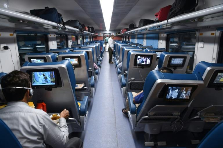 India's Tejas Express offers reclining seats with individual screens showing Bollywood movies and music videos