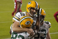 Green Bay Packers wide receiver Marquez Valdes-Scantling, bottom left, and quarterback Aaron Rodgers (12) celebrate after connecting on a touchdown pass during the second half of an NFL football game against the San Francisco 49ers in Santa Clara, Calif., Thursday, Nov. 5, 2020. (AP Photo/Tony Avelar)