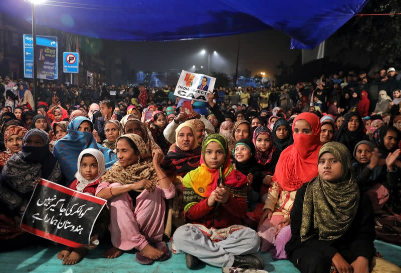 Local residents attend a protest against a new citizenship law, in New Delhi
