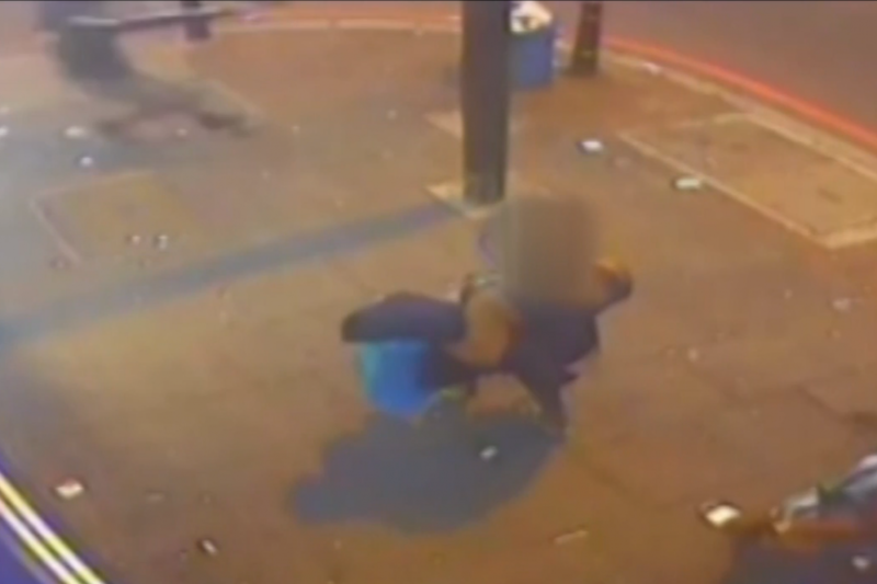 'Extremely dangerous': The man is seen running into the road before firing the gun a number of times (Met Police)