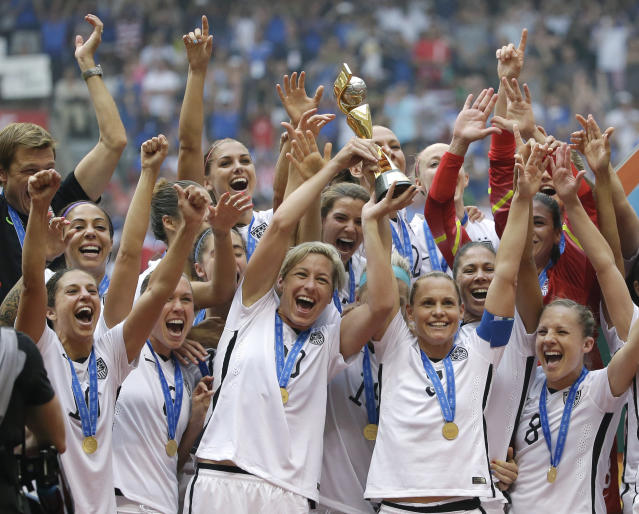FILE - In this July 5, 2015, file photo, the United States Women's National Team celebrates after they beat Japan in the FIFA Women's World Cup soccer championship in Vancouver, British Columbia. The United States women's soccer team will open next year with games at World Cup host France and Spain and finish a 10-game schedule leading to the tournament with a send-off match against Mexico at Harrison, N.J., on May 26, 2019. (AP Photo/Elaine Thompson, File)