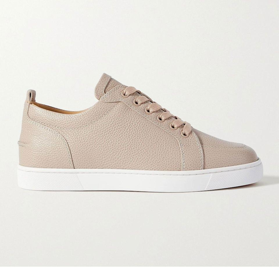 """<p><strong>Rantulow Sneakers</strong></p><p>mrporter.com</p><p><strong>$795.00</strong></p><p><a href=""""https://go.redirectingat.com?id=74968X1596630&url=https%3A%2F%2Fwww.mrporter.com%2Fen-us%2Fmens%2Fproduct%2Fchristian-louboutin%2Fshoes%2Flow-top-sneakers%2Frantulow-full-grain-leather-sneakers%2F13452677150145799&sref=https%3A%2F%2Fwww.esquire.com%2Fstyle%2Fmens-accessories%2Fadvice%2Fg2538%2Fluxury-sneaker-brands-worth-spending-money%2F"""" rel=""""nofollow noopener"""" target=""""_blank"""" data-ylk=""""slk:Shop Now"""" class=""""link rapid-noclick-resp"""">Shop Now</a></p><p>The brand with the red soles that have become synonymous with high-end footwear makes sneakers, too. Go figure. They're crafted in Italy from full-grain calfskin and feature zero visible branding. Until, that is, you take a step. Because <em>of course</em> Louboutin isn't going to skimp on the iconic sole, even if it's made from rubber instead of leather. Go figure (again). </p>"""