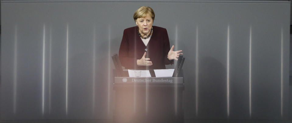 German Chancellor Angela Merkel delivers a speech about German government's policies to combat the spread of the coronavirus and COVID-19 disease at the parliament Bundestag, in Berlin, Germany, Thursday, Nov. 26, 2020. Merkel and the country's 16 state governors have agreed to extend a partial shutdown well into December in an effort to further reduce the rate of coronavirus infections ahead of the Christmas period. (AP Photo/Markus Schreiber)