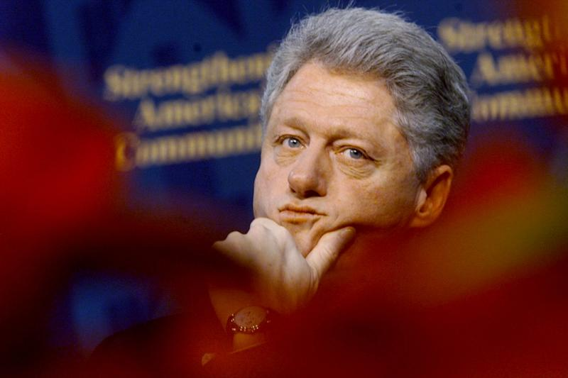 Clinton waits to speak on homelessness in Baltimore in December 1998.