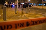 A member of the Israeli security forces at the scene of a stabbing attack in Netanya on November 2, 2015 (AFP Photo/Jack Guez)
