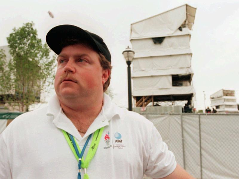 The day after the attack, the real Richard Jewell was photographed across from the tower where he found a bomb and warned visitors at Centennial Olympic Park in Atlanta.