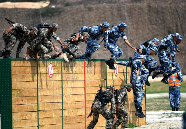 <p>Chinese marines compete during an obstacle course of the Seaborne Assault contest as part of the International Army Games 2018 on July 30, 2018 in Quanzhou, Fujian Province of China. (Photo: VCG via Getty Images) </p>