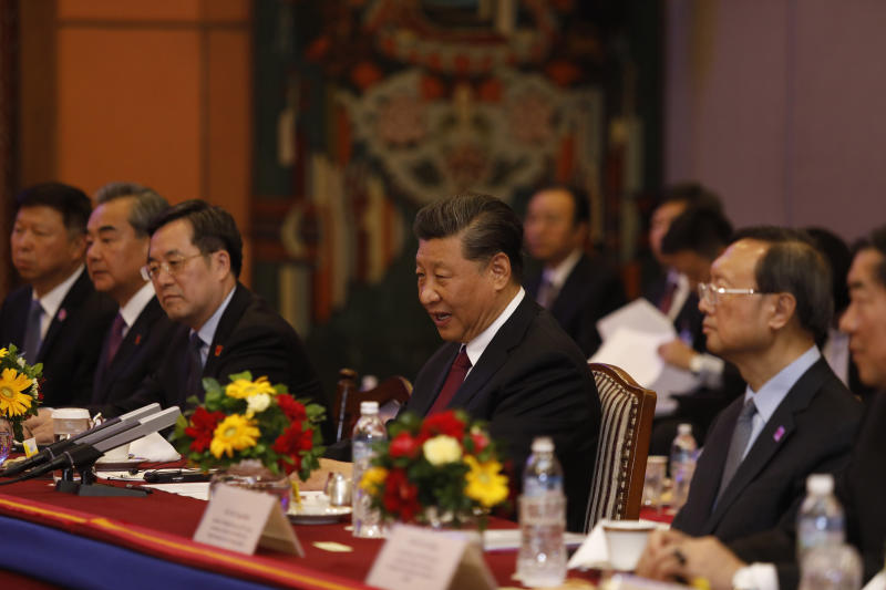 Chinese President Xi Jinping, center attends a bilateral meeting in Kathmandu, Nepal, Sunday, Oct. 13, 2019. Xi on Saturday became the first Chinese president in more than two decades to visit Nepal, where he's expected to sign agreements on some infrastructure projects. (Bikash Dware/The Rising Nepal via AP)