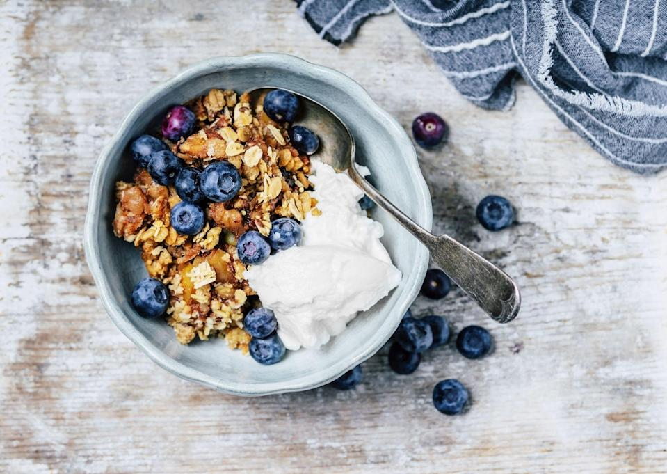 """<p>Whether you're sprinkling it on yogurt or eating it straight from the bag, <a href=""""https://www.goodhousekeeping.com/food-recipes/a22749958/best-ever-granola-recipe/"""" rel=""""nofollow noopener"""" target=""""_blank"""" data-ylk=""""slk:granola"""" class=""""link rapid-noclick-resp"""">granola</a> is a pantry staple that's just too tasty to pass up. But what is granola made of exactly and is it actually healthy for you? </p><p>This breakfast and snacking staple usually consists of rolled oats, nuts, honey, or other sweeteners. But over the years, many brands have started to add filler ingredients that pack in the added sugar and make a serving of granola practically the equivalent of eating a candy bar. That's why the <a href=""""https://www.goodhousekeeping.com/health/a40988/the-good-house-keeping-food-nutrition-brand-lab/"""" rel=""""nofollow noopener"""" target=""""_blank"""" data-ylk=""""slk:Good Housekeeping Nutrition Lab"""" class=""""link rapid-noclick-resp"""">Good Housekeeping Nutrition Lab</a> has taken the time to decipher the best health brands from the not-so-good stuff. </p><p>We evaluate hundreds of food products year-round to help you make the most nutritious choices for you and your family. In our tests, we analyzed over 50 different varieties of granola to find the best of the best. Our experts prioritized varieties with <strong>wholesome ingredient lists </strong>that you can read and pronounce. The <strong>first ingredient must be a </strong><strong>whole grain or whole food</strong> (i.e. oats, nuts, bran, legumes, etc). We looked for granola options with <strong>no trans fat, and at least 2 grams of fiber and protein per serving</strong>. Since serving sizes vary by brand, we did some math to make sure that 1/3 cup of each variety did <strong>not exceed more than 10 grams of added sugar and 300 calories.</strong> </p><p>See what brands made the cut below, and be sure to check out our all-star <a href=""""https://www.goodhousekeeping.com/health/diet-nutrition/g33456644/healthy-granola-bars/"""" rel=""""no"""
