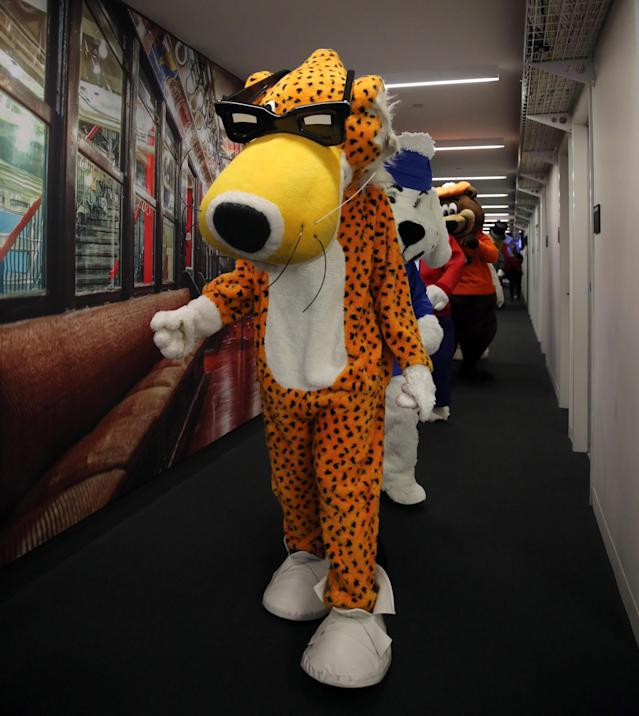 <p>Chester the Cheetah leads a parade of company mascots brought in as interns for the day at Yahoo Studios in New York City on Sept. 25, 2017. (Photo: Gordon Donovan/Yahoo News) </p>