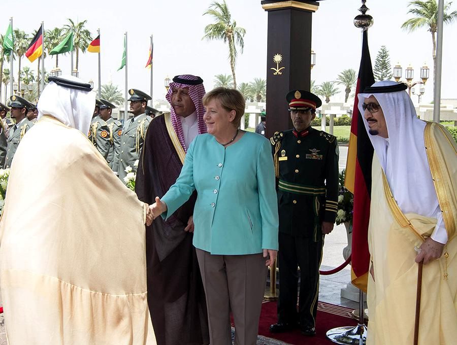 <p>German Chancellor Angela Merkel opted to not wear a headscarf for her meeting with Saudi Arabia's King Salman bin Abdul-Aziz al-Saud on Apr. 30 in Saudi Arabia, which has strict dress codes for women. (Photo: Bandar Algaloud/Saudi Kingdom Council handout/Anadolu Agency/Getty Images) </p>