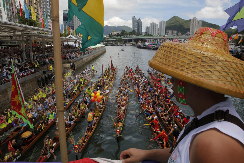 Participants splash water from their dragon boat as part of celebrations marking the Chinese Dragon Boat Festival, held throughout Hong Kong, Friday, June 7, 2019. Dragon boat races are in remembrance of Chu Yuan, an ancient Chinese scholar-statesman, who drowned in 277 B.C. while denouncing government corruption. (AP Photo/Kin Cheung)