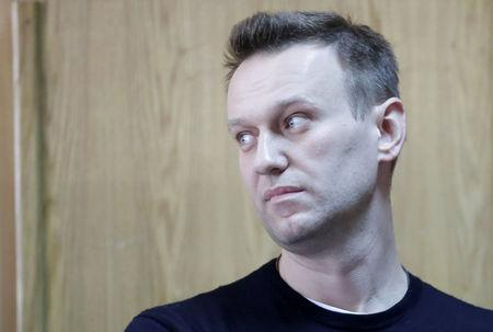 FILE PHOTO: Russian opposition leader Navalny attends a hearing after being detained at the protest against corruption and demanding the resignation of Prime Minister Dmitry Medvedev, at the Tverskoi court in Moscow