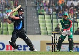 New Zealand batsman Colin Munro (L) plays a shot.