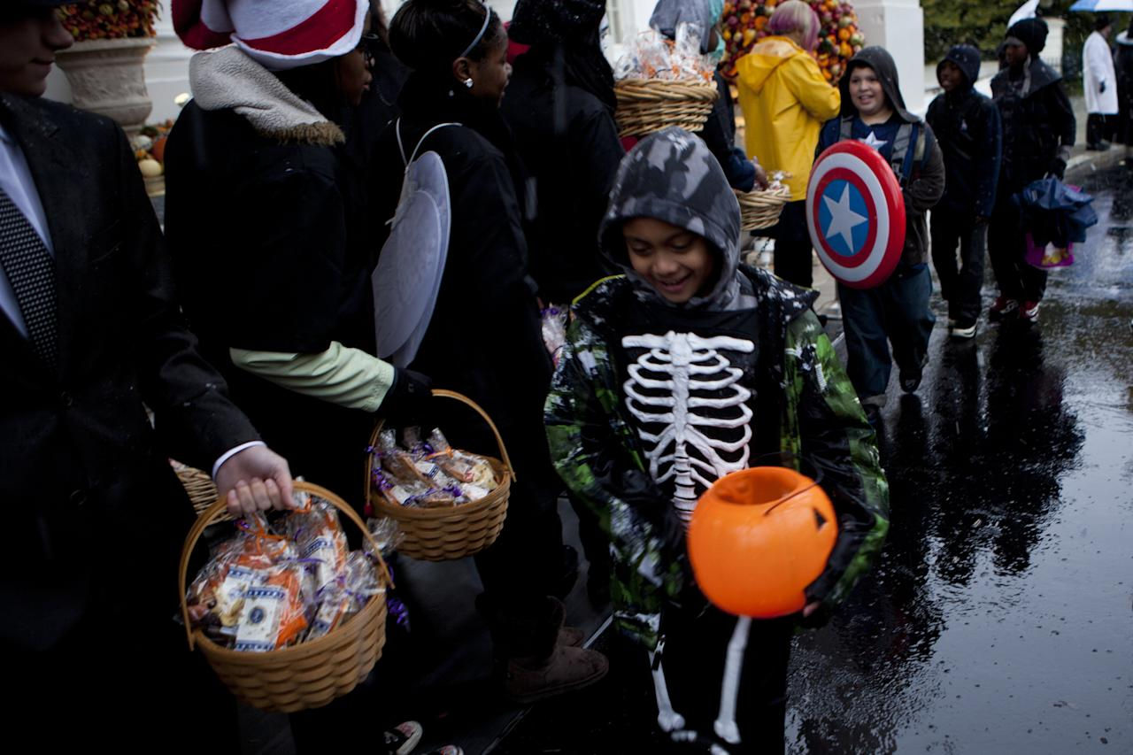 WASHINGTON - OCTOBER 29:  Trick or treaters arrive at the White House October 29, 2011 in Washington, DC.  President Barack Obama and first lady Michelle Obama hosted military families and other trick or treaters for a Halloween party.  (Photo by Brendan Smialowski/Getty Images)