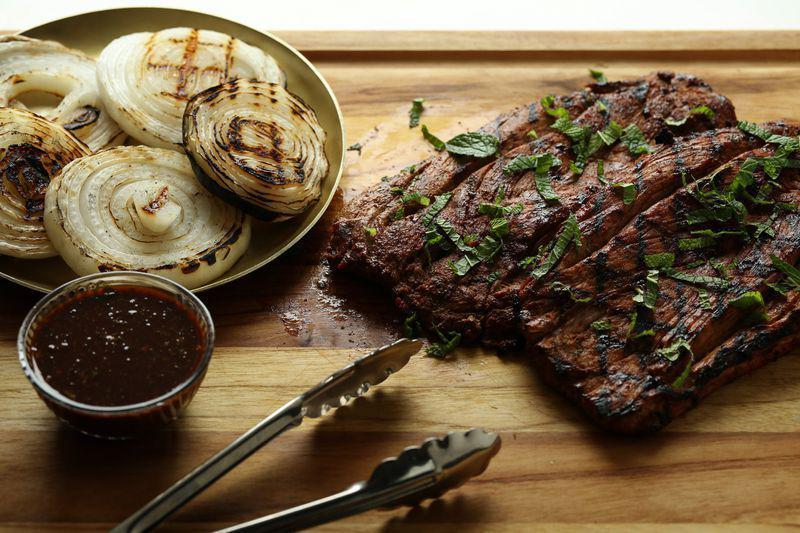 """<p>Pork tenderloin is a great weeknight protein when you're tired of chicken and beef. The unique combination of hoisin sauce plus fresh mint from your summer garden adds a new dimension to this tender piece of meat.</p> <p><a href=""""https://www.thedailymeal.com/recipes/grilled-butterflied-pork-tenderloin-hoisin-mint-sauce-recipe?referrer=yahoo&category=beauty_food&include_utm=1&utm_medium=referral&utm_source=yahoo&utm_campaign=feed"""" rel=""""nofollow noopener"""" target=""""_blank"""" data-ylk=""""slk:For the Grilled Butterflied Pork Tenderloin With Hoisin-Mint Sauce recipe, click here."""" class=""""link rapid-noclick-resp"""">For the Grilled Butterflied Pork Tenderloin With Hoisin-Mint Sauce recipe, click here.</a></p>"""